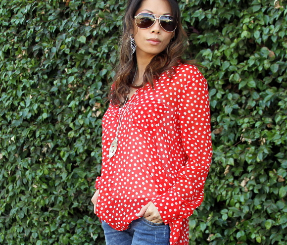 Polka dotted red blouse